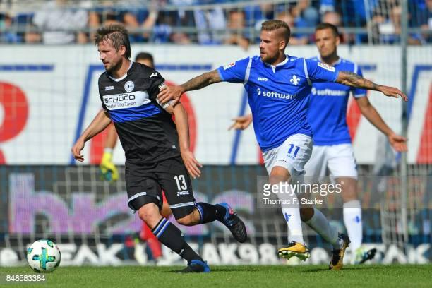 Tobias Kempe of Darmstadt tackles Julian Boerner of Bielefeld during the Second Bundesliga match between SV Darmstadt 98 and DSC Arminia Bielefeld at...