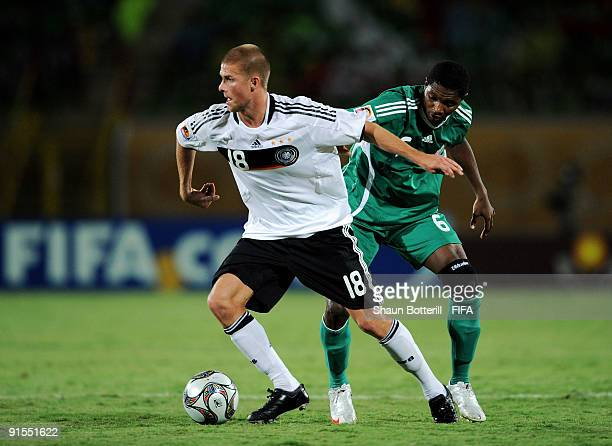 Tobias Kempe of Germany is challenged by Ibok Edet of Nigeria during the FIFA U20 World Cup Round of 16 match between Germany and Nigeria at the...