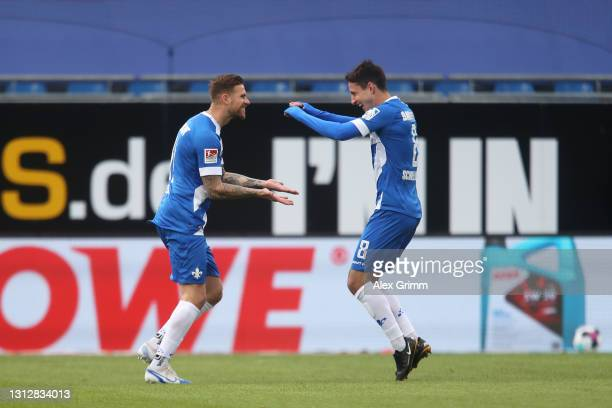 Tobias Kempe of SV Darmstadt 98 celebrates with Fabian Schnellhardt after scoring their side's first goal during the Second Bundesliga match between...