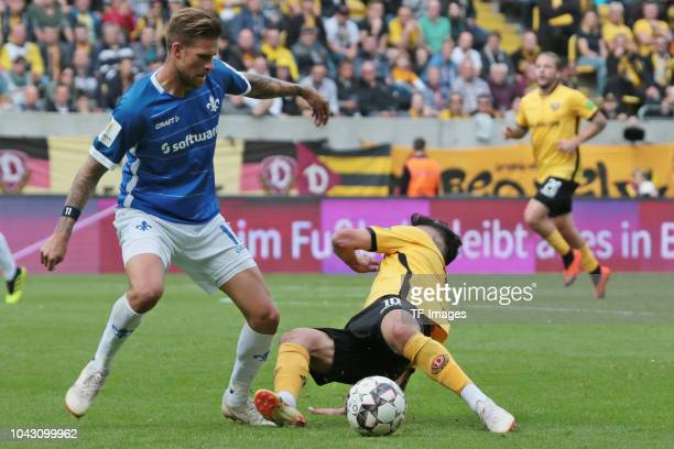 Tobias Kempe of SV Darmstadt and Aias Aosman of Dynamo Dresden battle for the ball during the Second Bundesliga match between SG Dynamo Dresden and...