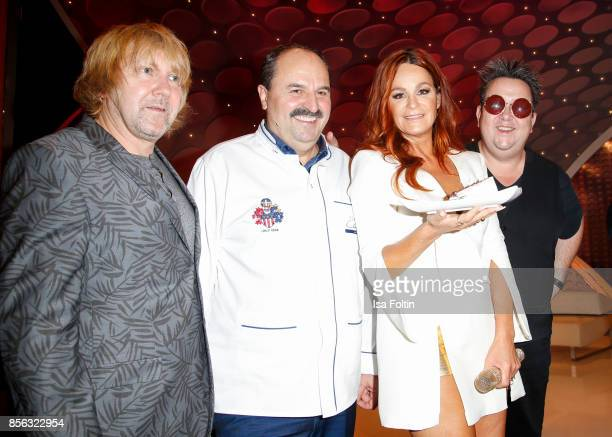 Tobias Kuenzel and Sebastian Krumbiegel of the band 'Die Prinzen' with TV cook Johann Lafer and German singer Andrea Berg during the tv show...