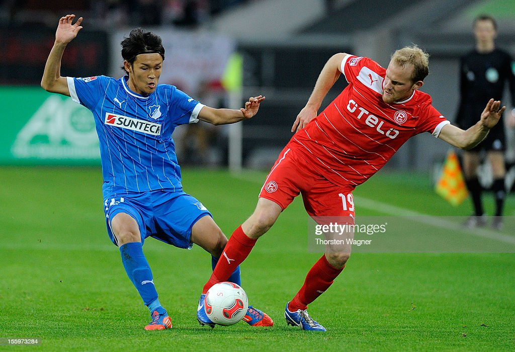 Tobias Levels (R) of Duesseldorf battles for the ball with Takashi Usami (L) of Hoffenheim during the Bundesliga march between Fortuna Duesseldorf and TSG 1899 Hoffenheim at Esprit-Arena on November 10, 2012 in Duesseldorf, Germany.