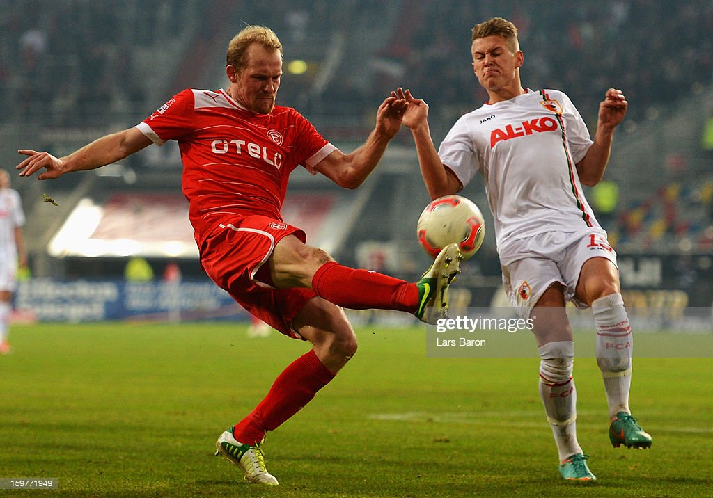 Tobias Levels of Duesseldorf is challenged by Ronny Philip of Augsburg during the Bundesliga match between Fortuna Duesseldorf 1895 and FC Augsburg at Esprit-Arena on January 20, 2013 in Duesseldorf, Germany.