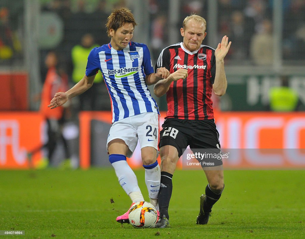Tobias Levels (R) of FC Ingolstadt challenges Genki Haraguchi of Hertha BSC during the Bundesliga match between FC Ingolstadt and Hertha BSC at Audi Sportpark on October 24, 2015 in Ingolstadt, Germany.