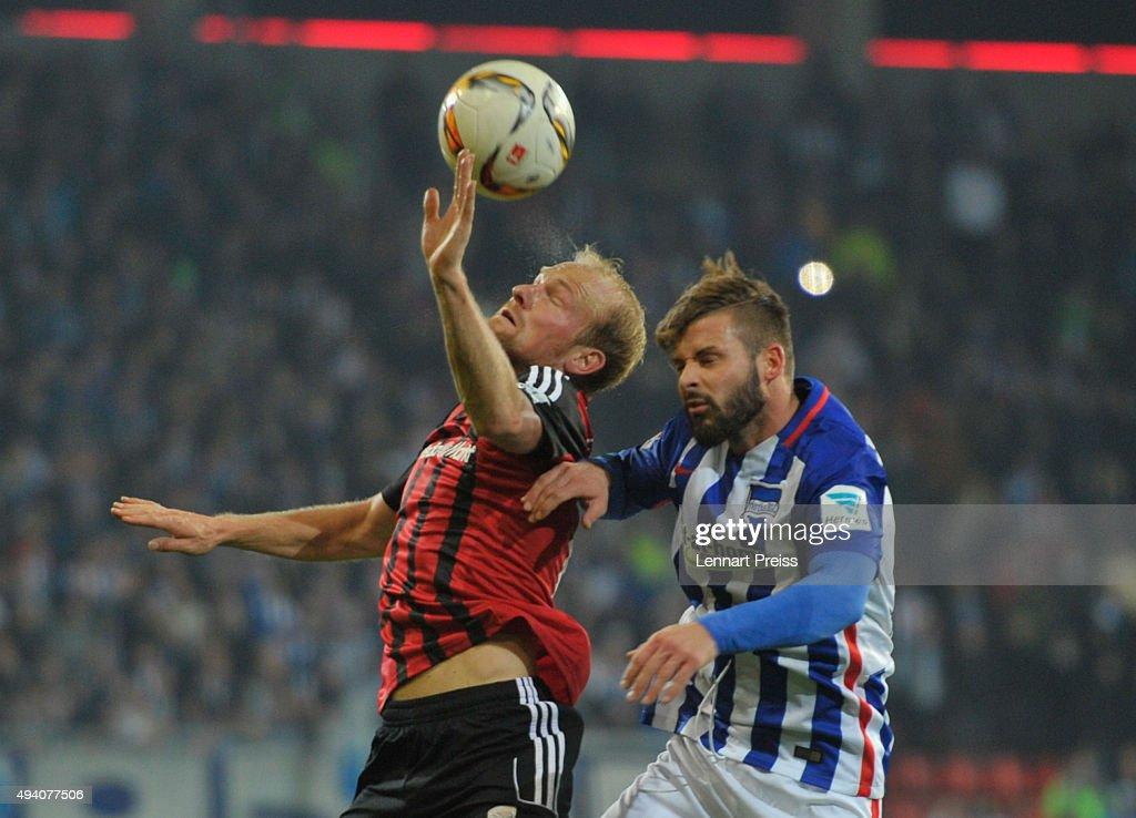 Tobias Levels (L) of FC Ingolstadt challenges Marvin Plattenhardt of Hertha BSC during the Bundesliga match between FC Ingolstadt and Hertha BSC at Audi Sportpark on October 24, 2015 in Ingolstadt, Germany.