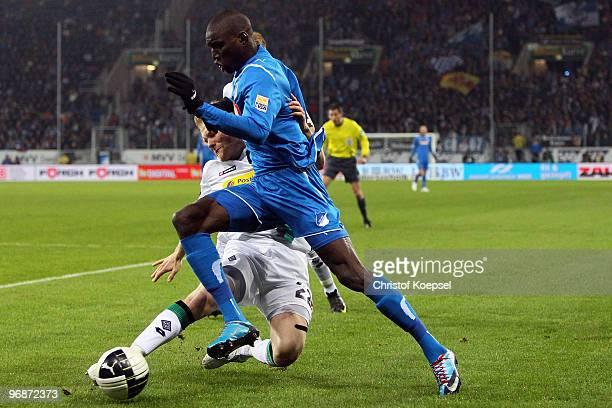 Tobias Levels of Gladbach is challenged by Demba Ba of Hoffenheim during the Bundesliga match between 1899 Hoffenheim and Borussia Moenchengladbach...