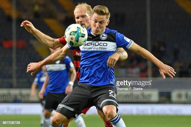 Tobias Levels of Ingolstadt and Konstantin Kerschbaumer of Bielefeld fight for the ball during the Second Bundesliga match between DSC Arminia...