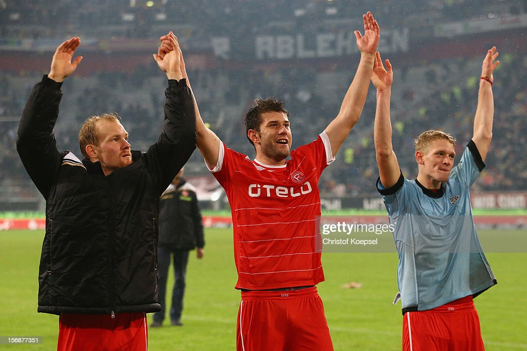 Tobias Levels, Stefan Reisinger and Johannes van den Bergh of Duesseldorf celebrate after the Bundesliga match between Fortuna Duesseldorf and Hamburger SV at Esprit-Arena on November 23, 2012 in Duesseldorf, Germany.