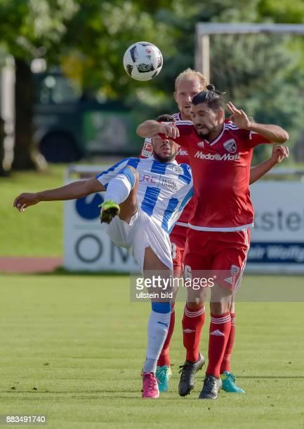 Tobias Levels und Almog Cohen im Zweikampf mit Elias Kachunga waehrend dem Fussball Testspiel FC Ingolstadt 04 gegen Huddersfield Town FC fuer die...