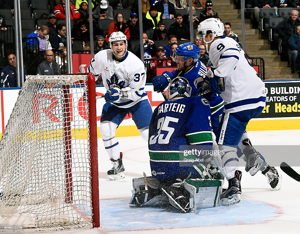 Tobias Lindberg #37 celebrates when Colin Smith #9 of the Toronto Marlies puts one by Chad Billins #41 and Michael Garteig #35 of the Utica Comets during game action on November 26, 2016 at Air Canada Centre in Toronto, Ontario, Canada.