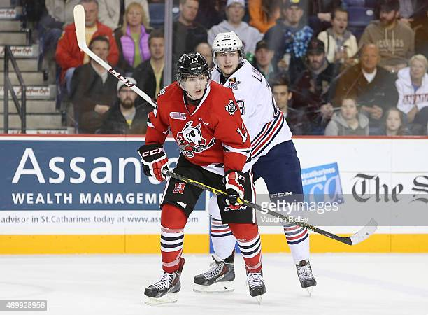 Tobias Lindberg of the Oshawa Generals battles with Graham Knott of the Niagara IceDogs during Game 3 of the Eastern Conference SemiFinals at the...