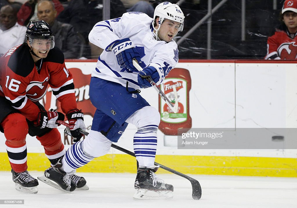 Tobias Lindberg #46 of the Toronto Maple Leafs shoots in front of Jacob Josefson #16 of the New Jersey Devils during the third period at the Prudential Center on April 9, 2016 in Newark, New Jersey. The Devils defeated the Maple Leafs 5-1.