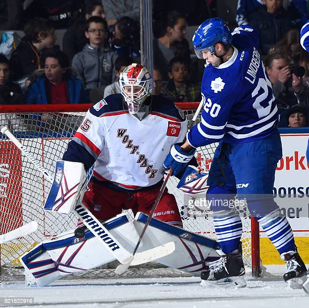 Tobias Lindberg of the Toronto Marlies deflects a shot against Magnus Hellberg of the Hartford Wolf Pack during game action on April 13 2016 at the...
