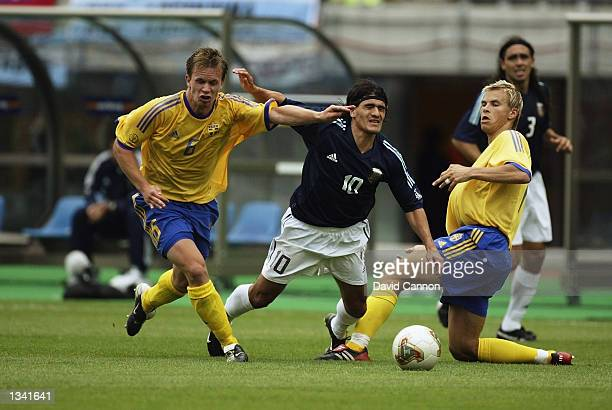 Tobias Linderoth and Niclas Alexandersson of Sweden tackle Ariel Ortega of Argentina during the Group F match of the World Cup Group Stage played at...