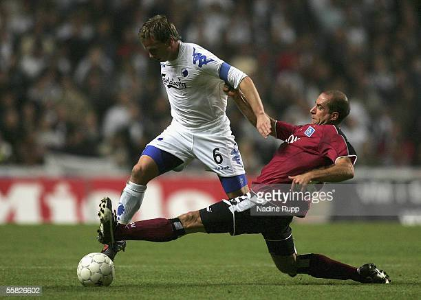 Tobias Linderoth of Copenhagen competes with Stefan Beinlich of HSV during the UEFA Cup first round second leg match between FC Copenhagen and...