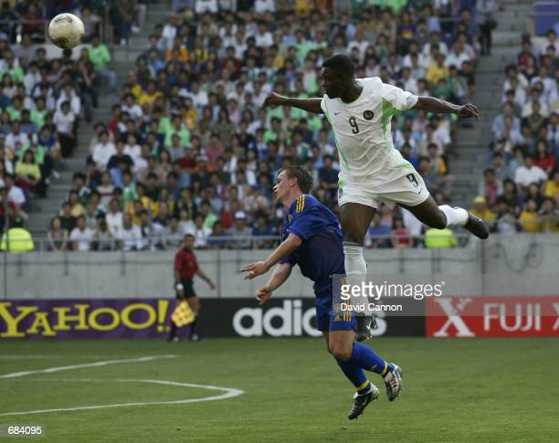 Tobias Linderoth of Sweden and Bartholomew Ogbeche of Nigeria during the first half of the Sweden v Nigeria, Group F, World Cup Group Stage match...