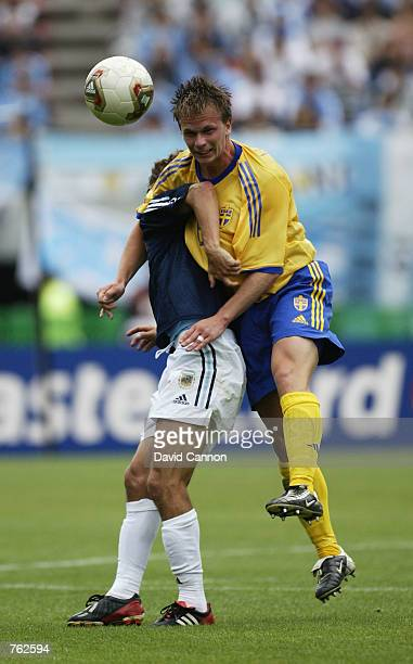 Tobias Linderoth of Sweden rises above Pablo Aimar of Argentina during the FIFA World Cup Finals 2002 Group F match played at the Miyagi Stadium in...