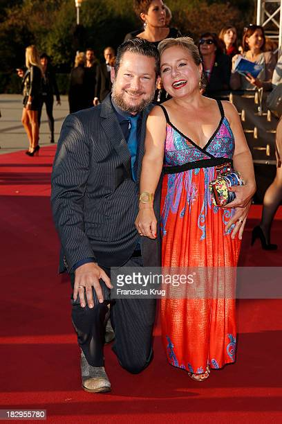 Tobias Materna and ChrisTine Urspruch attend the Deutscher Fernsehpreis 2013 Red Carpet Arrivals at Coloneum on October 02 2013 in Cologne Germany