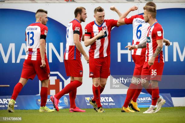 Tobias Mohr of 1. FC Heidenheim celebrates with teammates after scoring his sides first goal during the Second Bundesliga match between 1. FC...