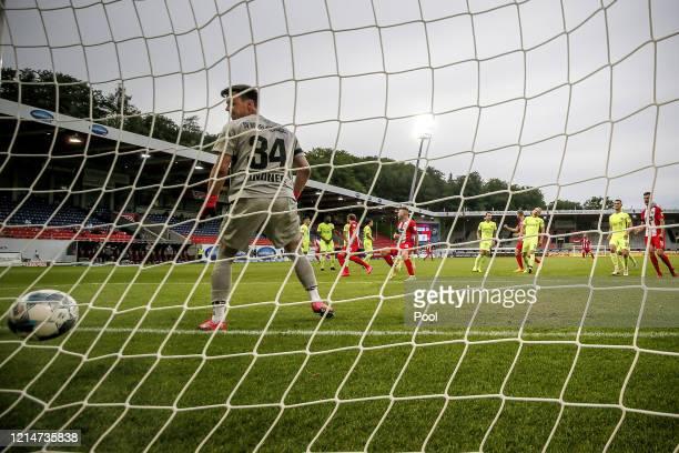 Tobias Mohr of 1. FC Heidenheim scores his sides first goal past Heinz Lindner of SV Wehen Wiesbaden during the Second Bundesliga match between 1. FC...