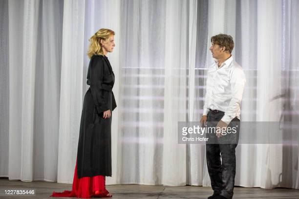 """Tobias Moretti as """"Jedermann"""" and Caroline Peters as """"Buhlschaft"""" performing on stage during the outdoor TV and press rehearsal of the production..."""