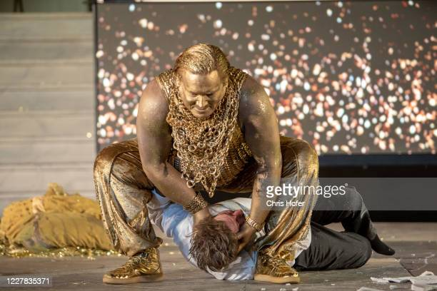 """Tobias Moretti as """"Jedermann"""" and Christoph Franken as """"Mammon"""" performing on stage during the outdoor TV and press rehearsal of the production..."""