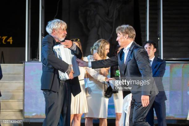 """Tobias Moretti as """"Jedermann"""" and Helmut Mooshammer as """"Ein armer Nachbar"""" performing on stage during the outdoor TV and press rehearsal of the..."""