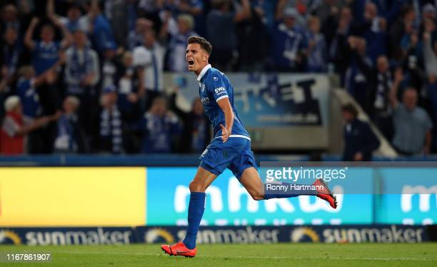 Tobias Mueller of Magdeburg celebrates after scoring the 11 equalizer during the 3 Liga match between 1 FC Magdeburg and MSV Duisburg at MDCC Arena...