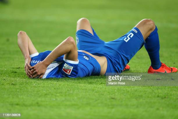 Tobias Muller of 1.FC Magdeburg lies dejected following the Second Bundesliga match between 1. FC Magdeburg and 1. FC Heidenheim 1846 at MDCC Arena...