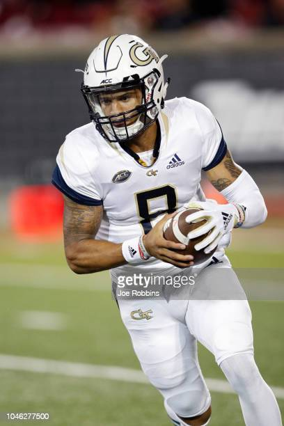 Tobias Oliver of the Georgia Tech Yellow Jackets runs the ball in the second half of the game against the Louisville Cardinals at Cardinal Stadium on...