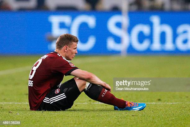 Tobias Pachonik of Nuernberg looks dejected with confirmed relegation of his team after the Bundesliga match between FC Schalke 04 and 1 FC Nuernberg...
