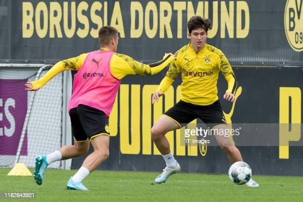 Tobias Raschl of Borussia Dortmund and Leonardo Balerdi of Borussia Dortmund battle for the ball during the Borussia Dortmund Training Session on...