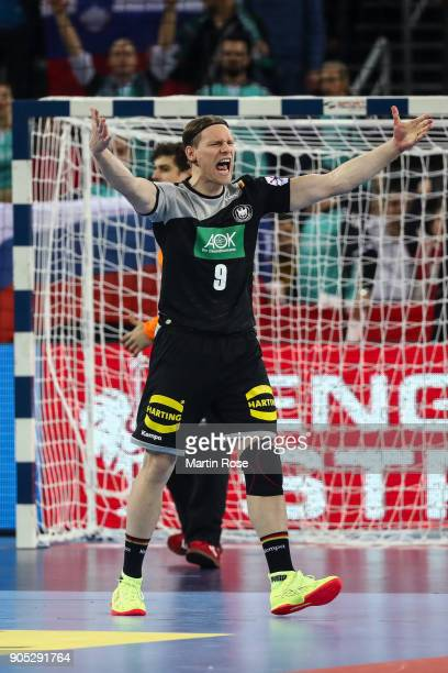Tobias Reichmann of Germany reacts after equalising goal after the Men's Handball European Championship Group C match between Slovenia and Germany at...
