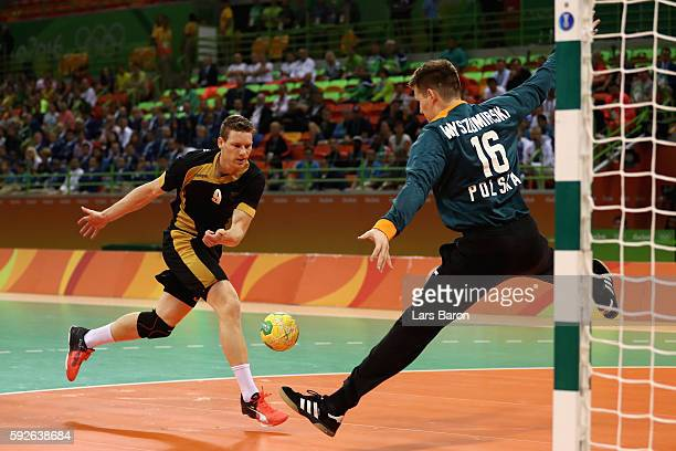 Tobias Reichmann of Germany takes a shot against Piotr Wyszomirski of Poland during the Men's Bronze Medal Match between Poland and Germany on Day 16...