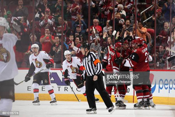 Tobias Rieder Brendan Perlini Oliver EkmanLarsson and Luke Schenn of the Arizona Coyotes celebate after Perlini scored a goal against the Ottawa...