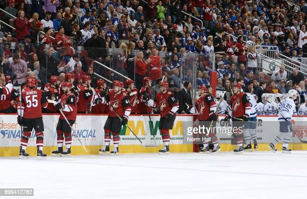 Tobias Rieder Kevin Connauton Brendan Perlini Derek Stepan and Luke Schenn of the Arizona Coyotes are congratulated by Jason Demers and teammates...