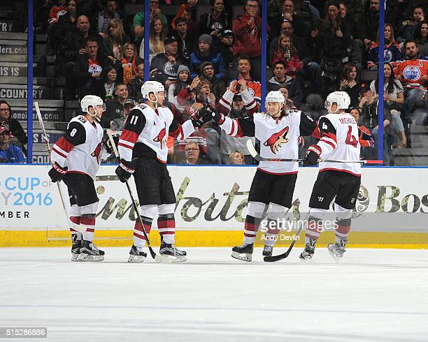 Tobias Rieder Martin Hanzal Viktor Tikhonov and Zbynek Michalek of the Arizona Coyotes celebrate after a goal during the game against the Edmonton...