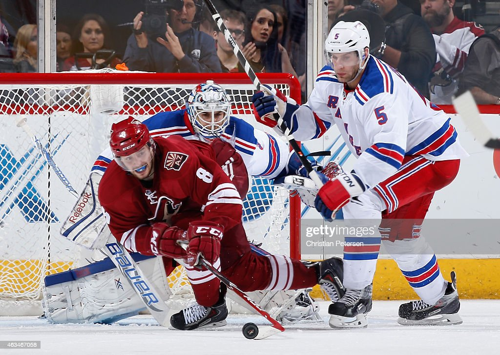 Tobias Rieder #8 of the Arizona Coyotes attempts to control the puck for a shot on goaltender Cam Talbot #33 of the New York Rangers during the third period of the NHL game at Gila River Arena on February 14, 2015 in Glendale, Arizona.