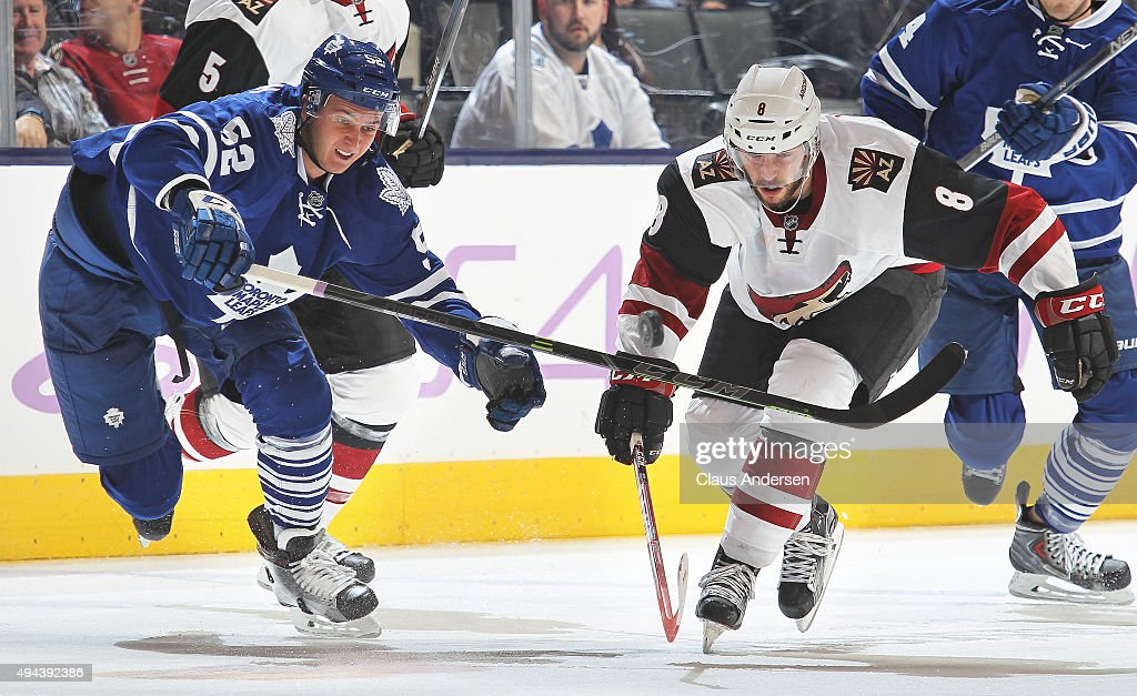 Tobias Rieder #8 of the Arizona Coyotes battles against Martin Marincin #52 of the Toronto Maple Leafs during an NHL game at the Air Canada Centre on October 26, 2015 in Toronto, Ontario, Canada. The Coyotes defeated the Leafs 4-3.