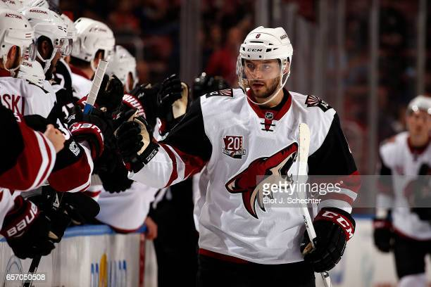 Tobias Rieder of the Arizona Coyotes celebrates his goal with teammates during the first period against the Florida Panthers at the BBT Center on...