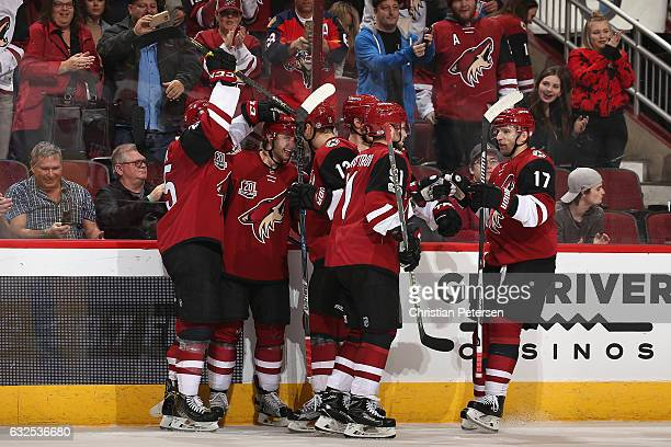 Tobias Rieder of the Arizona Coyotes celebrates with Ryan White Peter Holland Alexander Burmistrov and Radim Vrbata after Rieder scored the game...