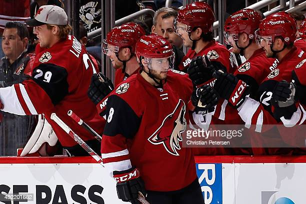 Tobias Rieder of the Arizona Coyotes celebrates with teammates on the bench after Rieder scored a second period goal against the Pittsburgh Penguins...
