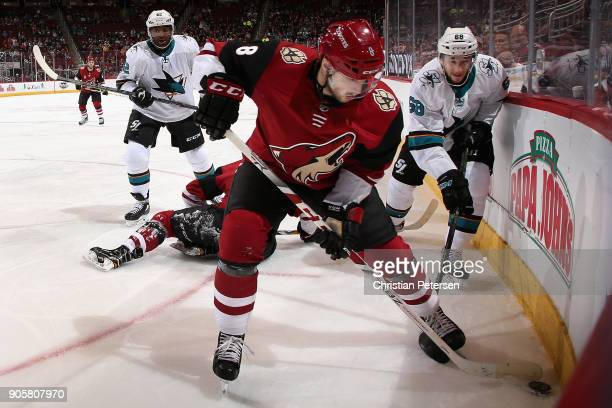 Tobias Rieder of the Arizona Coyotes controls the puck under pressure from Joel Ward and Melker Karlsson of the San Jose Sharks during the first...