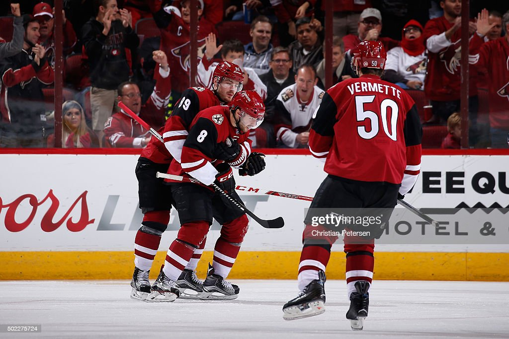 Tobias Rieder #8 of the Arizona Coyotes is congratulated by Mikkel Boedker #89 and Antoine Vermette #50 after scoring a goal against the Columbus Blue Jackets during the NHL game at Gila River Arena on December 17, 2015 in Glendale, Arizona. The Blue Jackets defeated the Coyotes 7-5.
