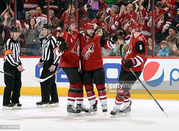 Tobias Rieder of the Arizona Coyotes is congratulated by teammates Oliver EkmanLarsson and Connor Murphy after his first period goal against the...