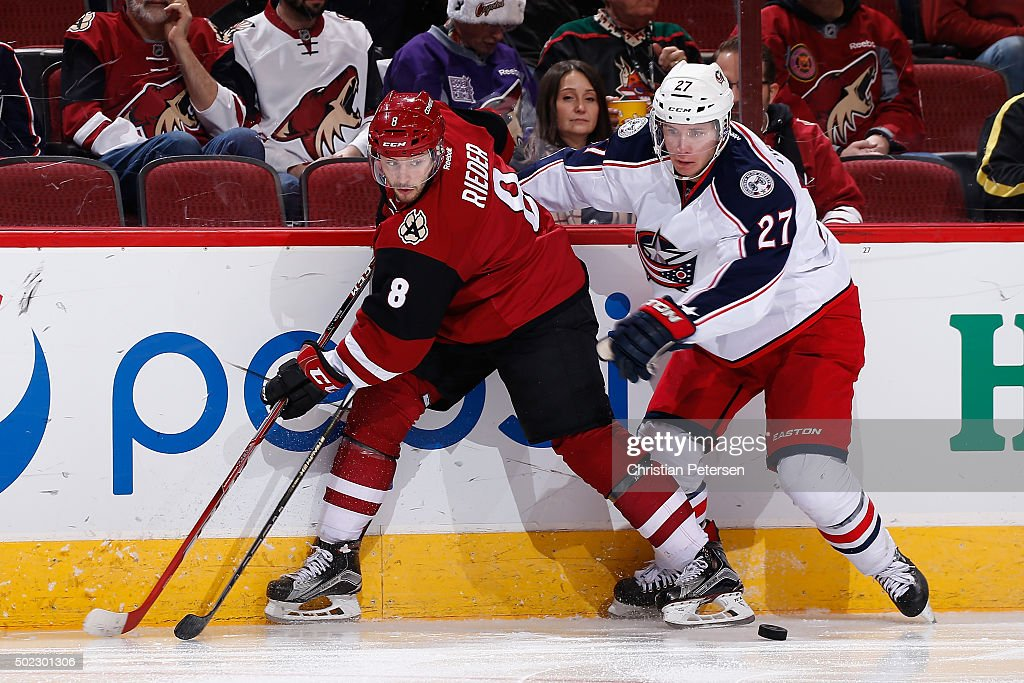 Tobias Rieder #8 of the Arizona Coyotes looks to pass against Ryan Murray #27 of the Columbus Blue Jackets during the NHL game at Gila River Arena on December 17, 2015 in Glendale, Arizona. The Blue Jackets defeated the Coyotes 7-5.