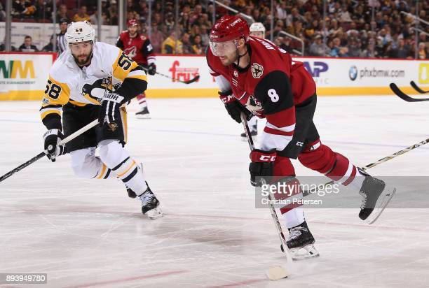 Tobias Rieder of the Arizona Coyotes looks to shoot the puck ahead of Kris Letang of the Pittsburgh Penguins during the first period of the NHL game...