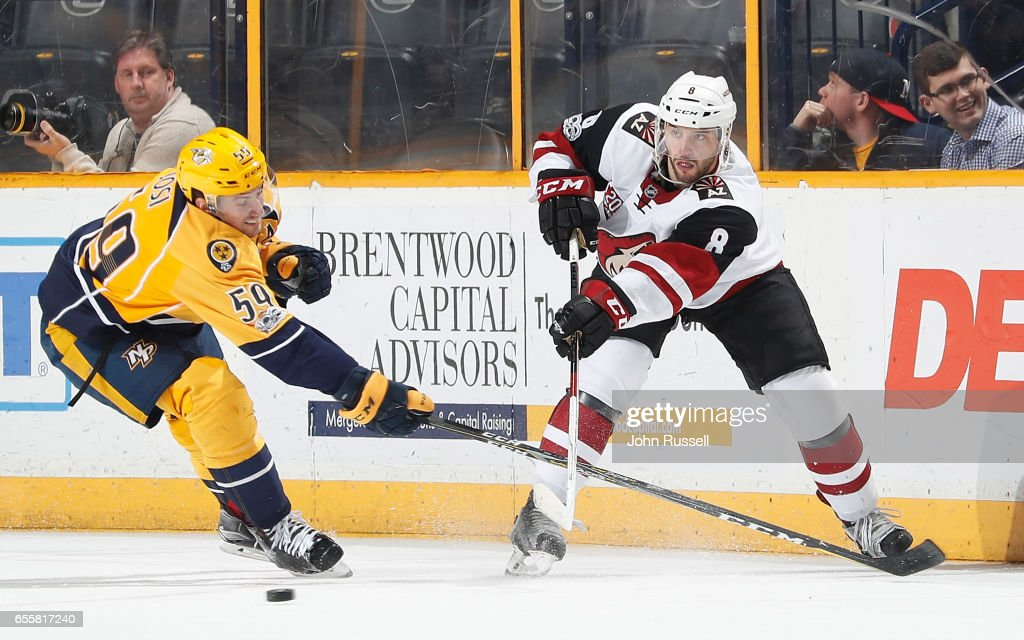 Tobias Rieder #8 of the Arizona Coyotes passes the puck against Roman Josi #59 of the Nashville Predators during an NHL game at Bridgestone Arena on March 20, 2017 in Nashville, Tennessee.
