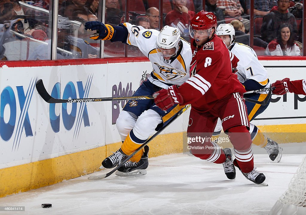 Tobias Rieder #8 of the Arizona Coyotes skates after the puck ahead of Craig Smith #15 of the Nashville Predators during the second period of the NHL game at Gila River Arena on December 11, 2014 in Glendale, Arizona. The Predators defeated the Coyotes 5-1.