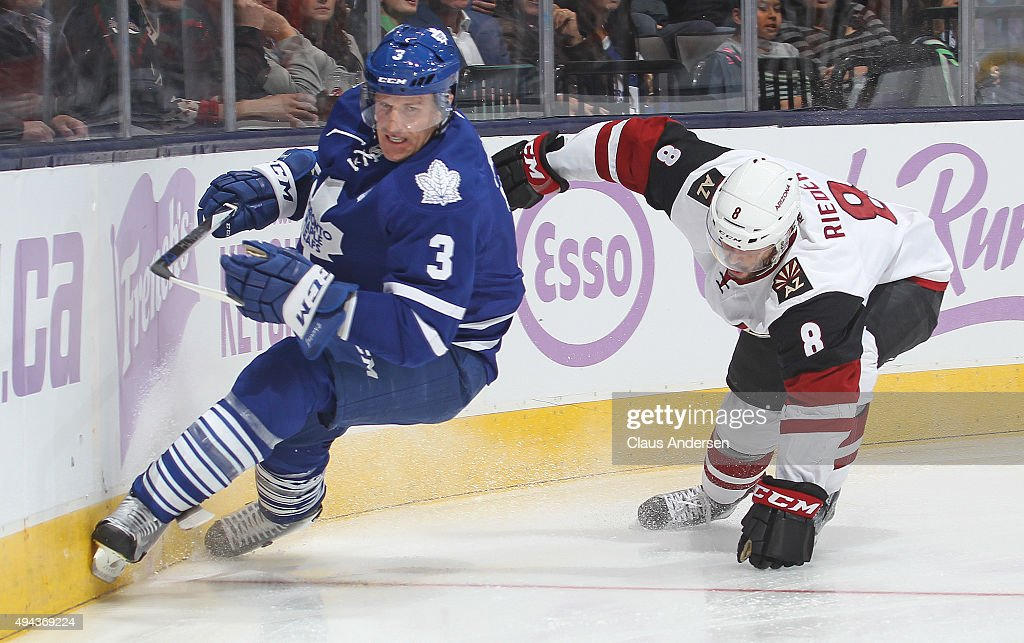 Tobias Rieder #8 of the Arizona Coyotes skates against Dion Phaneuf #3 of the Toronto Maple Leafs during an NHL game at the Air Canada Centre on October 26, 2015 in Toronto, Ontario, Canada.